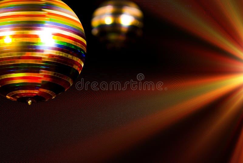 Colored disco ball. In a discotheque stock image