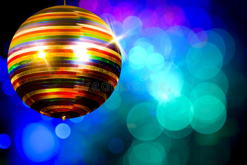 Colored disco ball. In a discotheque royalty free stock images