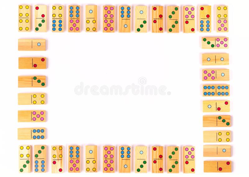Colored domino pieces on white background. Celebration,party, kids, educational background. Flat lay. Copy space. stock photo