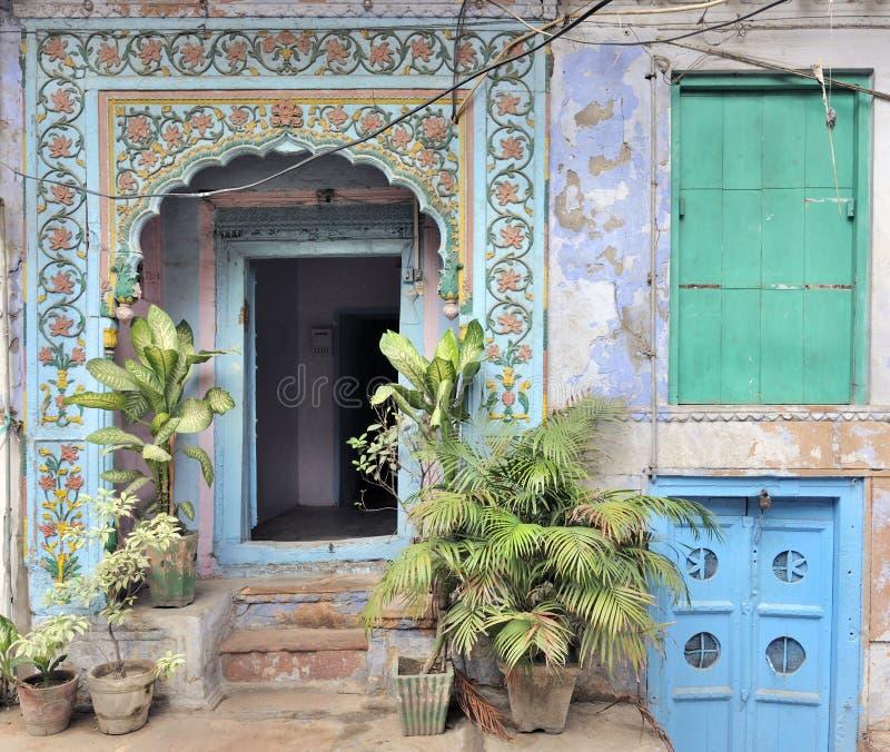 Colored doorways in Old Delhi, India. Traditional colored house and doorways in Old Delhi, India royalty free stock photos