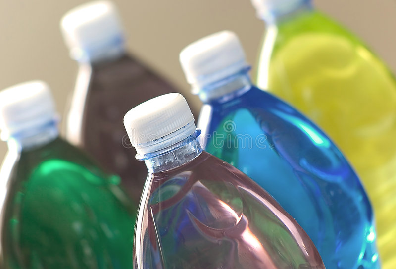 Colored drinks - plastic bottles royalty free stock images