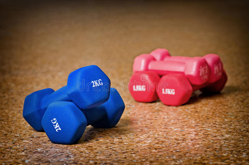 Colored dumbbells royalty free stock photo