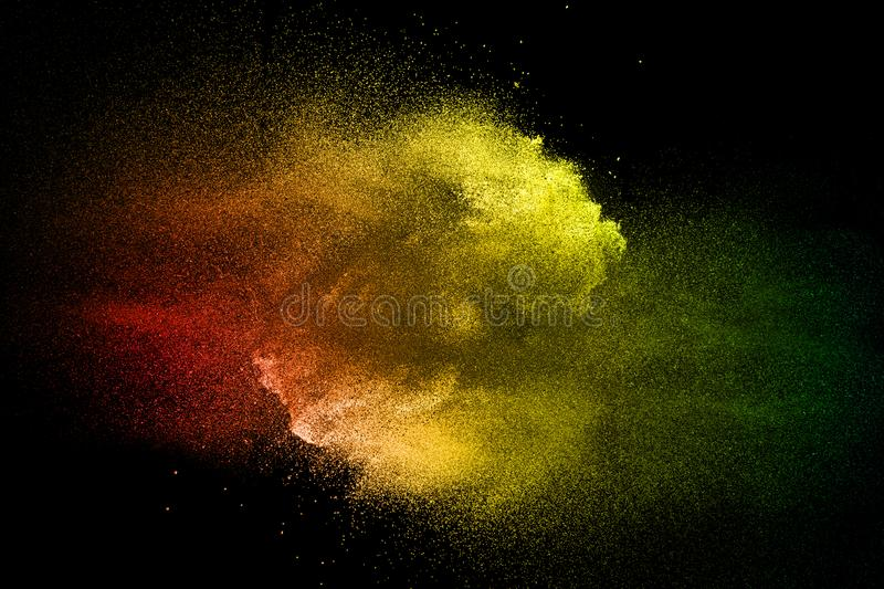 Colored dust splash cloud on dark background. Launched colorful particles on background. Multi color powder explosion on black background. Colored dust splash royalty free stock photos