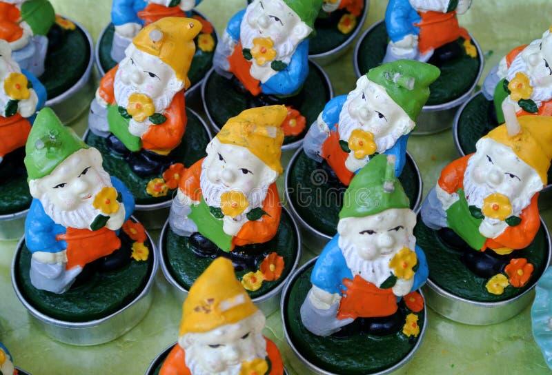 Dwarfs shaped candles stock image