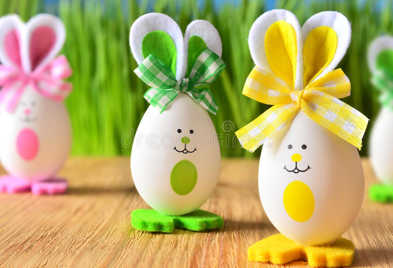 Colored easter eggs bunny on wooden boards stock photos