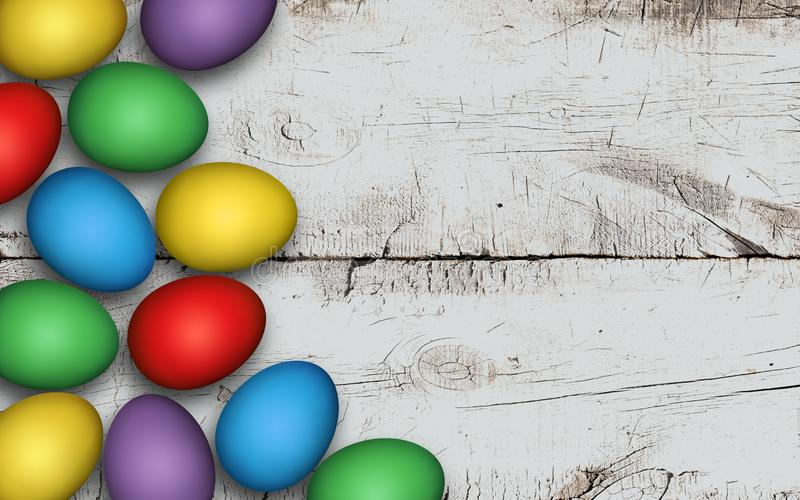 Colored easter eggs on wooden background. Rustic white background. Colorful Easter eggs on a white wooden table, decoration stock images