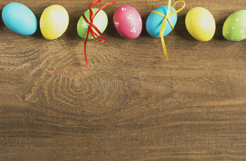 Colored Easter eggs on a wooden table royalty free stock image
