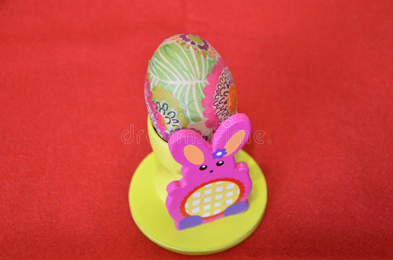 Colored egg on holder royalty free stock image