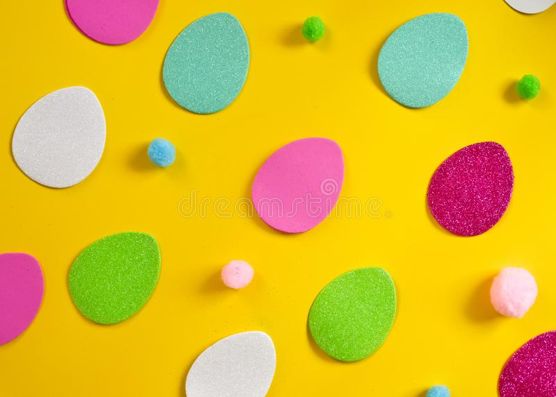 Colored eggs and small fluffy clumps as a symbol of Easter. eggs made of  foamiran. stock photography