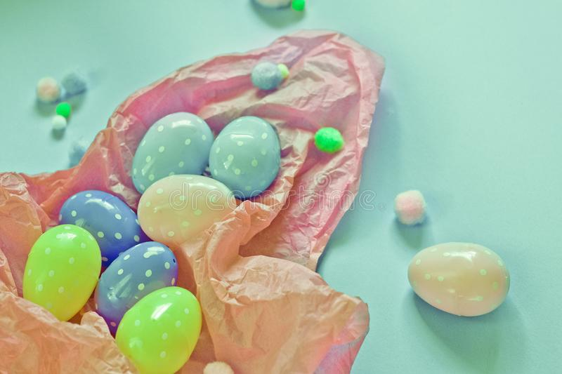 Colored eggs and small fluffy clumps as a symbol of Easter. eggs made of foamira stock photography