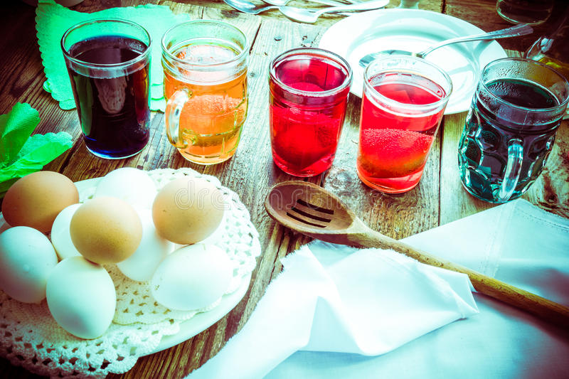 Colored eggs wooden table rural hut royalty free stock photography