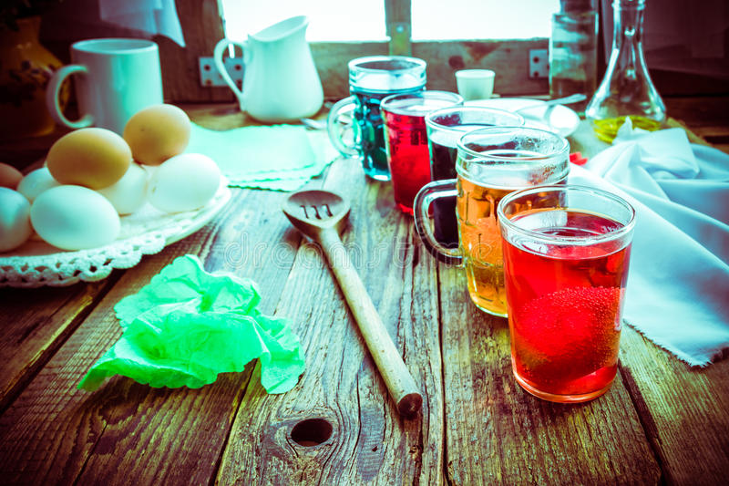 Colored eggs wooden table rural hut royalty free stock image