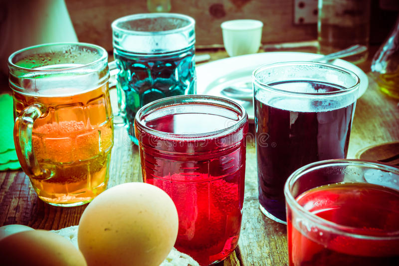 Colored eggs wooden table rural hut stock image