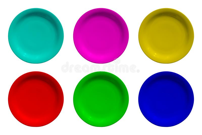 Colored ceramic round plates isolated on white background royalty free stock image