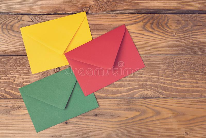 Colored envelopes on wooden table. Concept holidays, communications. Business mail, blogging and office correspondence background. stock images
