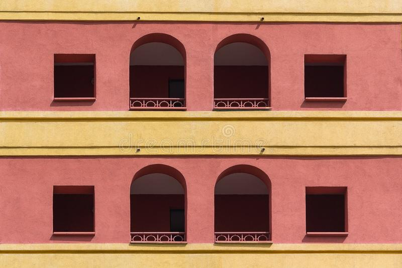 Colored facade of the building with a loggia. Architecture royalty free stock photography