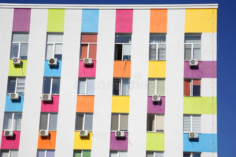 Colored facade of a residential building with air conditioning. The colored facade of a residential building with air conditioning stock photography