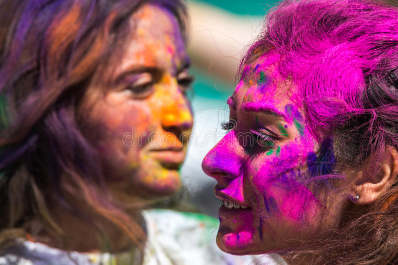 Color Fest faces. Two young women with colorful faces at Color Fest stock photos