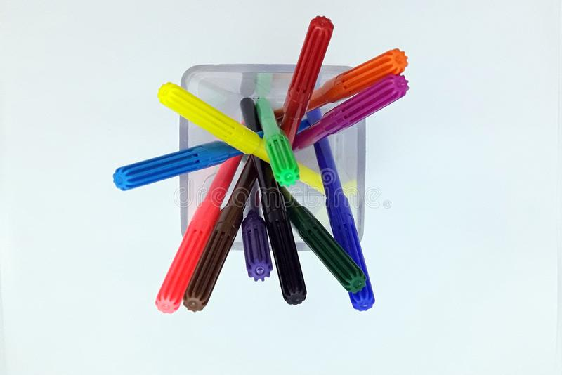 Felt-tip pens in glass. The colored felt-tip pens on the white stock photos