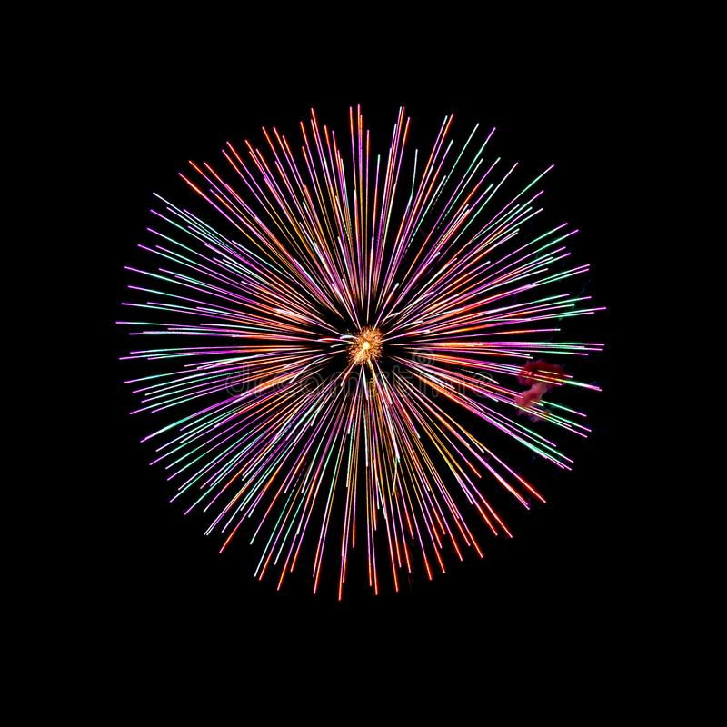 Fireworks isolated on a black sky background. Colored fireworks isolated on a black sky background royalty free stock images