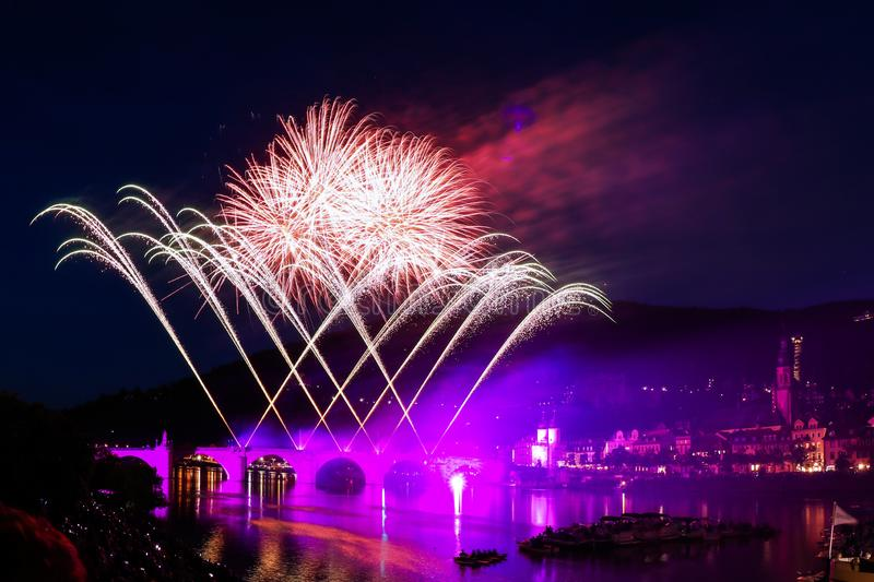 Colored fireworks over the river stock photography