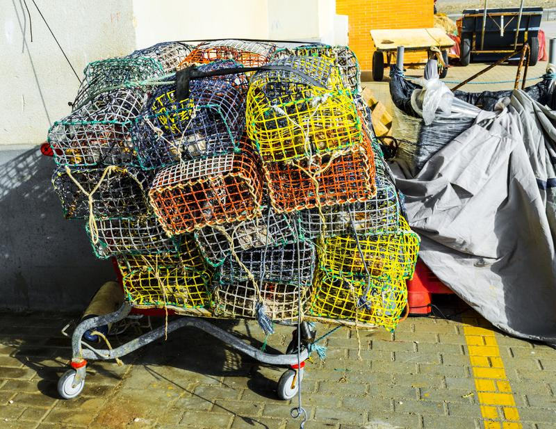 Colored Fishing Cages in a Spanish Winter Day. Fishing cages in the fish market of Estepona during winter stock photos