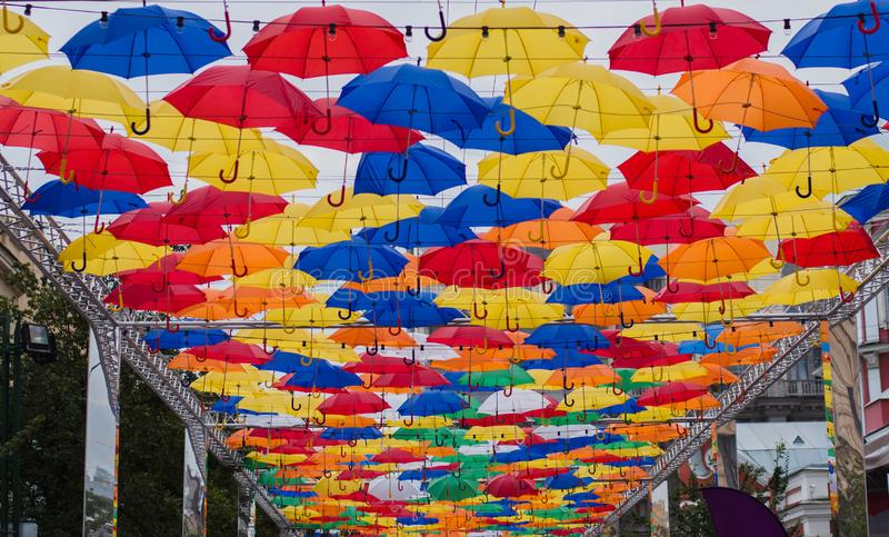 Colored floating umbrellas flying in the sky зонты украшение улицы royalty free stock images