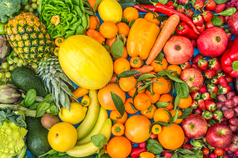 Colored Fruits and vegetables background stock photos