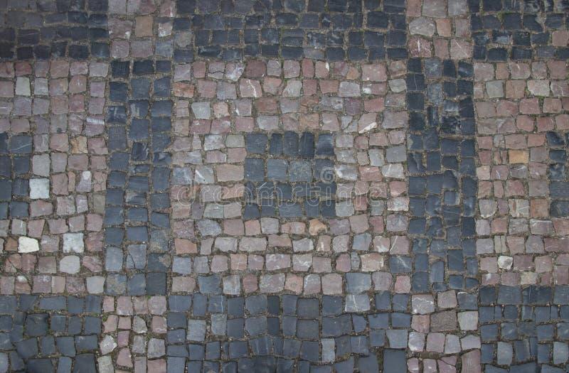 Colored geometric granite paving stones royalty free stock photo