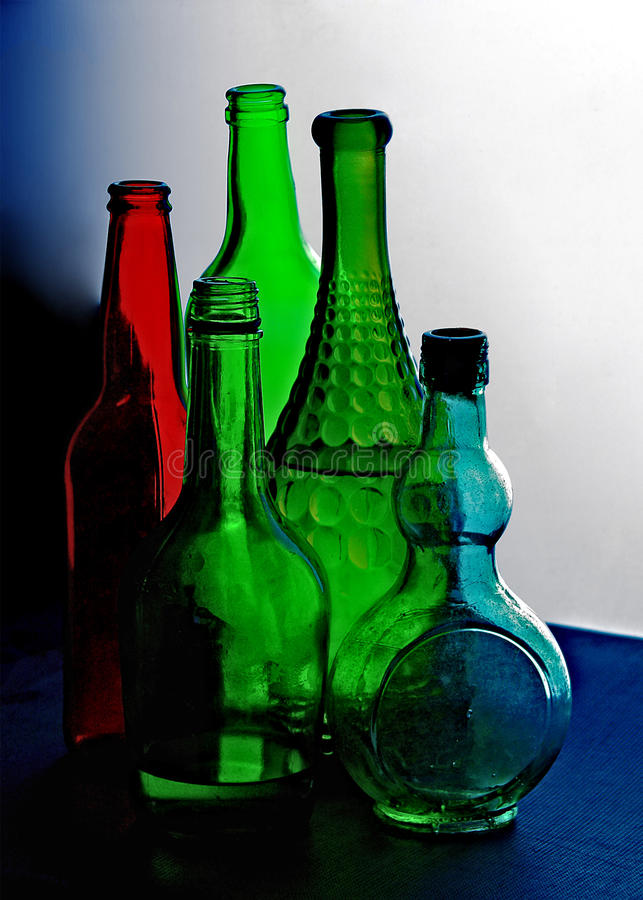 Colored glass bottles royalty free stock images