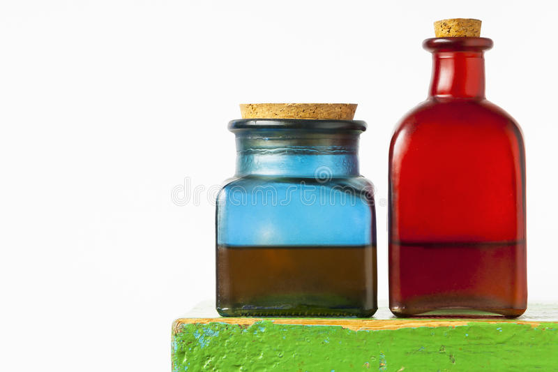 Colored glass bottles stock photos