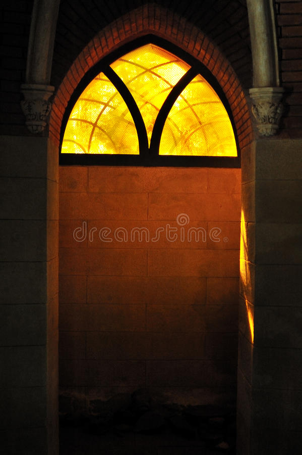 Colored glass, lights across stained gothic window. Colored glass, lights across stained window gothic stock images