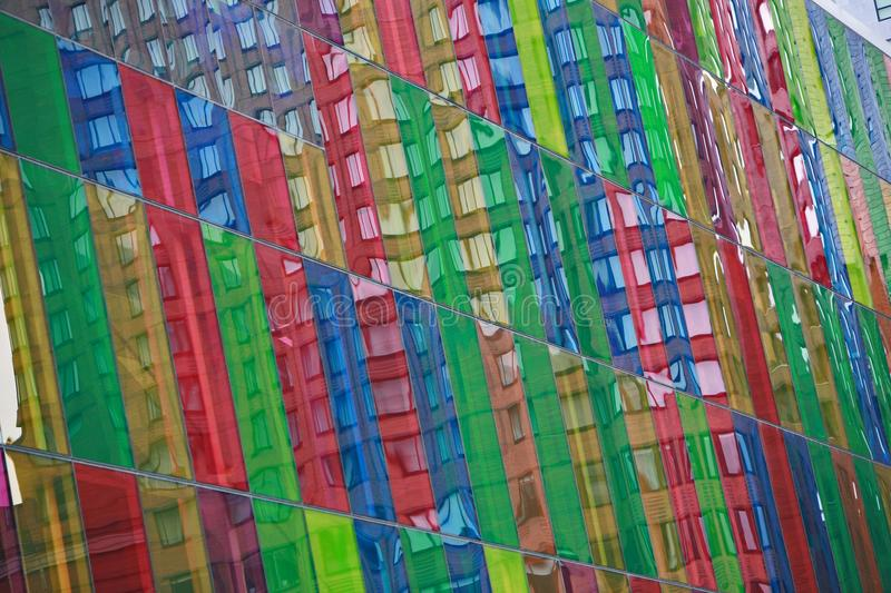Colored glass window on building in montreal. Multi colored glass window on a building in Montreal canada stock images