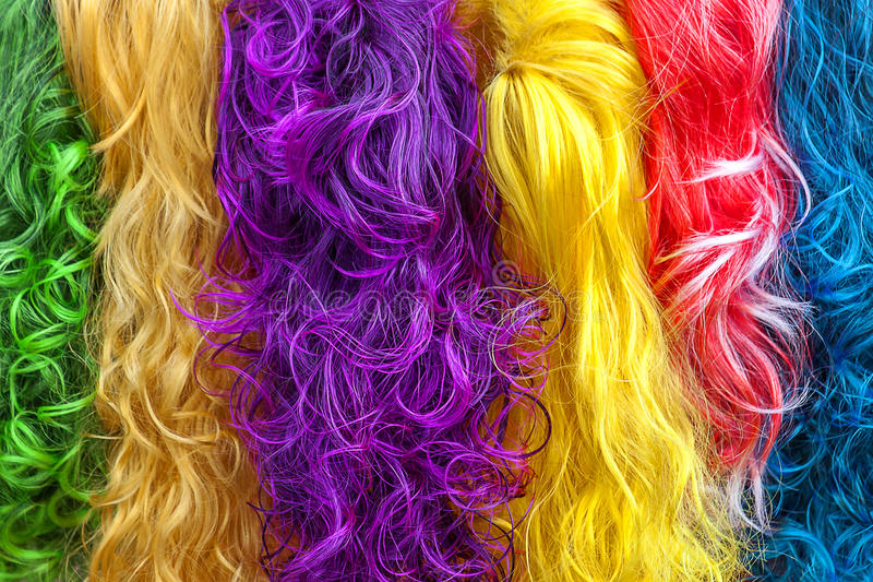 Colored hair. I heavy colors as red, blue, green, yellow and purple colors stock images