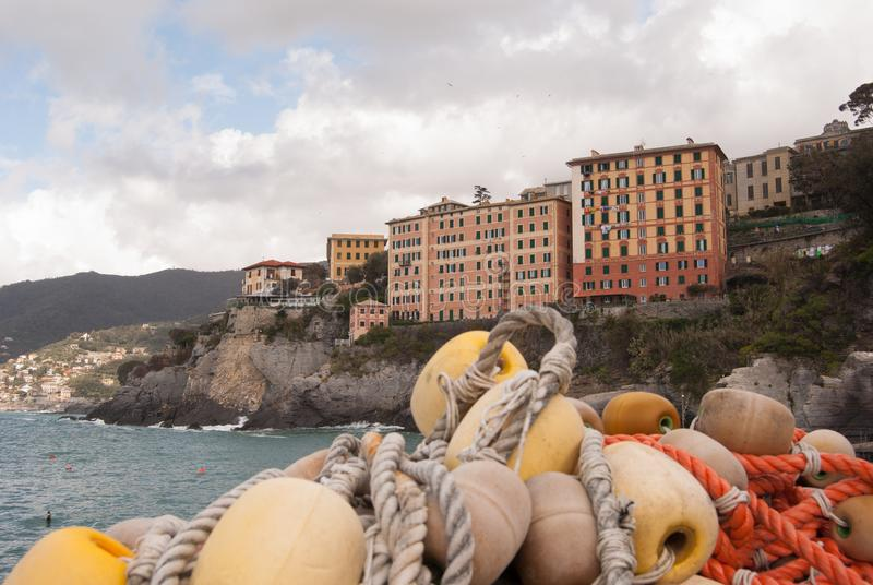 Colored houses in the coast of Camogli with a fisherman`s networ stock photography