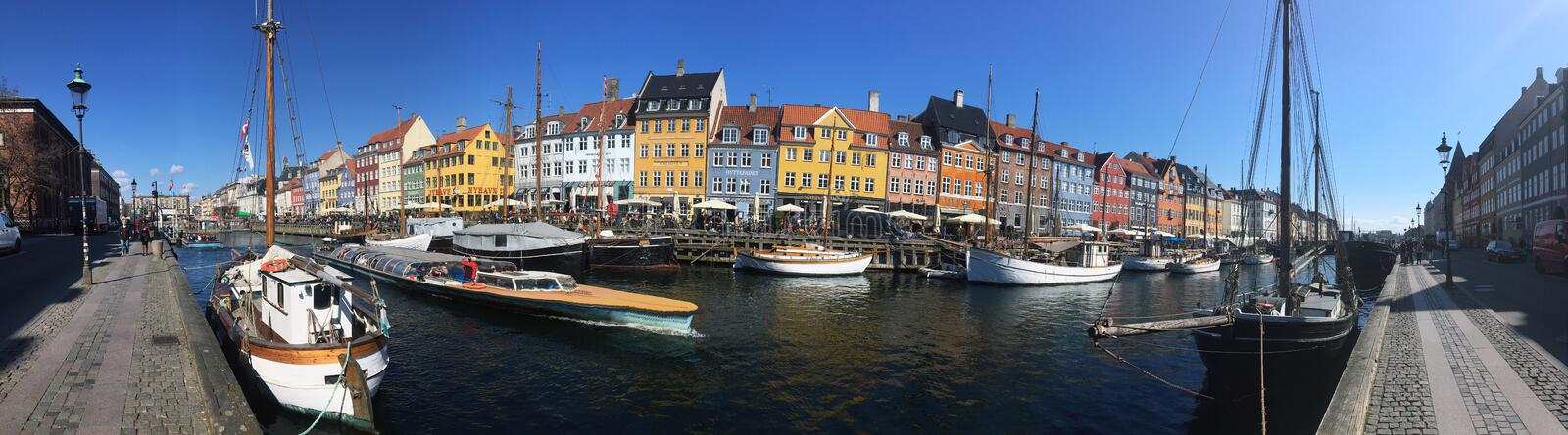 Colored houses near the water channel. Vacation in Europe. Copenhagen. stock image