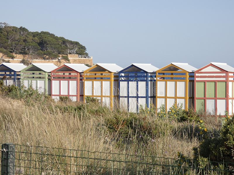Colored huts for bathers to change their clothes. Typical colorful huts on the Catalan coast, so that bathers can change their clothes, dry, change their stock photo