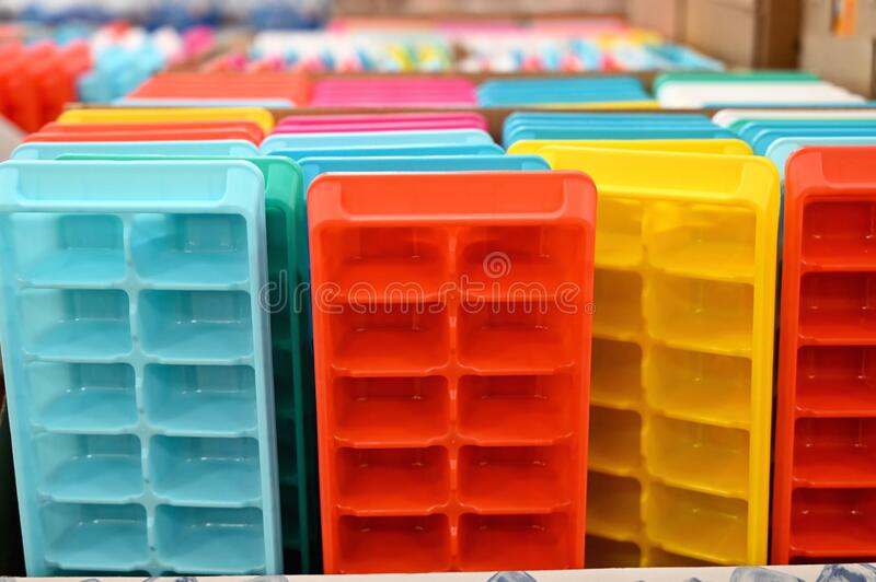 Colored Ice Cube Trays. Brightly colored plastic ice cube trays for sale in the market stock images
