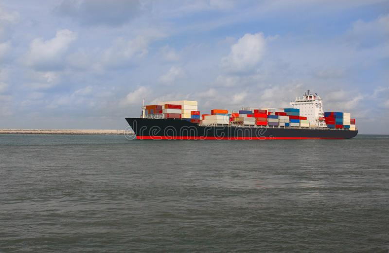 a commercial image cargo ship in coastal of Lagos port. A colored import ship loaded with containers in a port coastline getting set to berth suitable for stock images