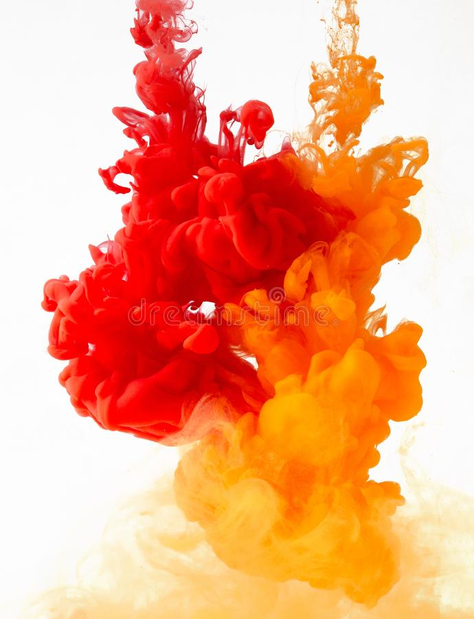Colored ink in water creating abstract shape, isolated on white background stock photos