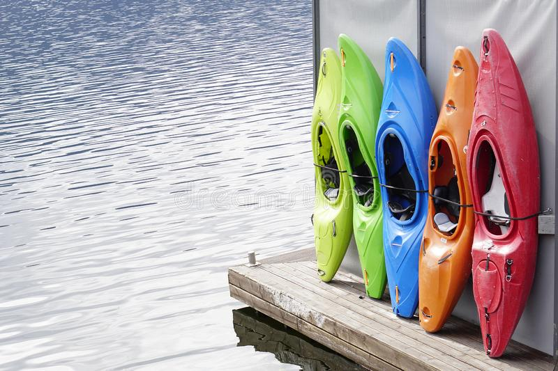 Colored Kayaks for rental at lake stock photos