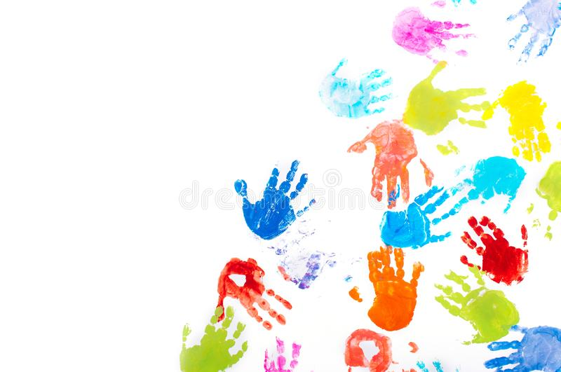 Colored kids handprints on white background with copy space stock images