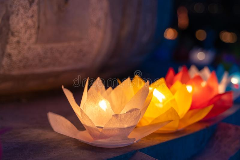 Colored lanterns and garlands at night on Vesak day for celebrating Buddha`s birthday in Eastern culture, that made from paper an. D candle royalty free stock photos