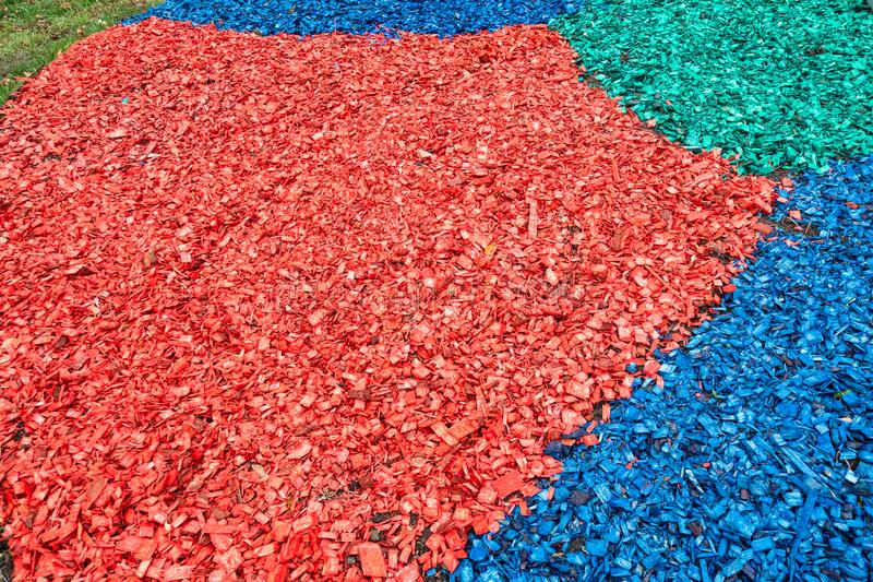 Colored layers of wooden mulch on surface of lawn stock images