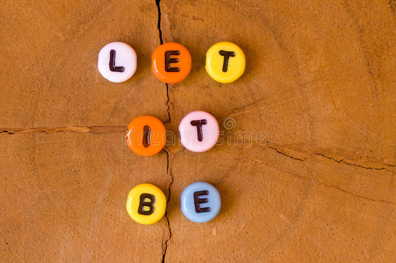 Colored let it be. On wooden background stock image