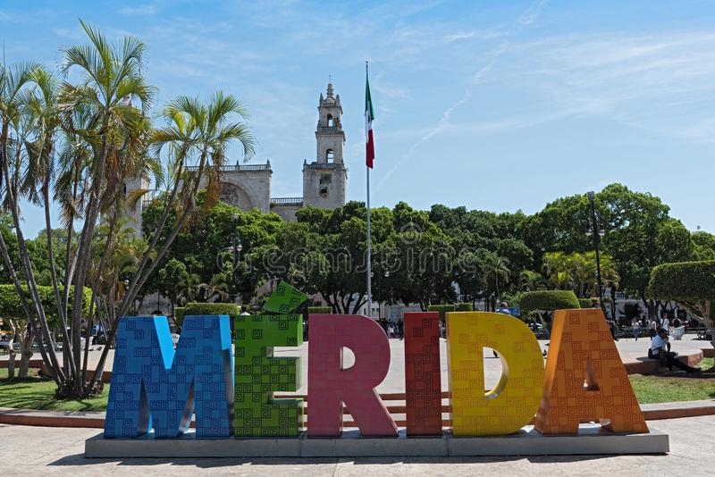 Colored lettering of the Mexican city Merida with mexican flag and cathedral.  royalty free stock images
