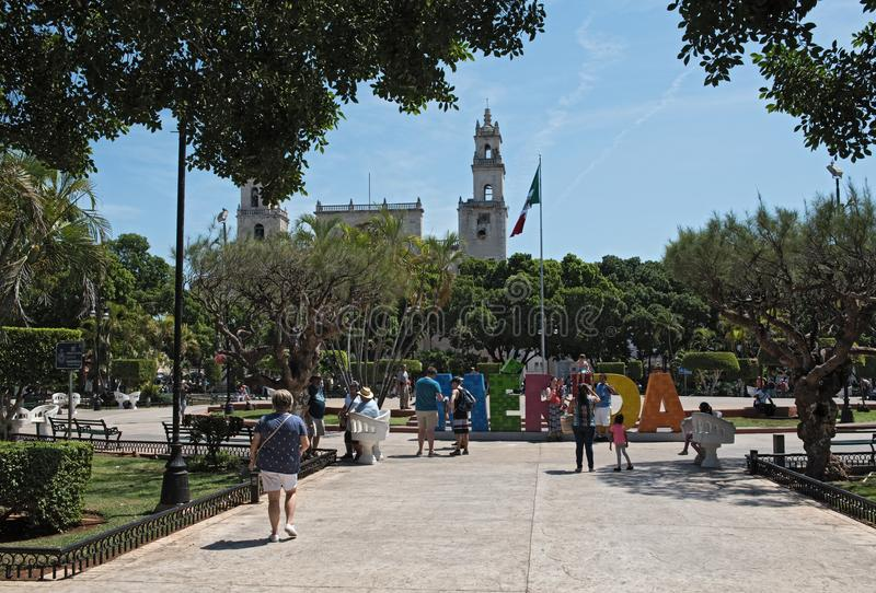 Colored lettering of the Mexican city Merida with mexican flag and cathedral.  stock photo