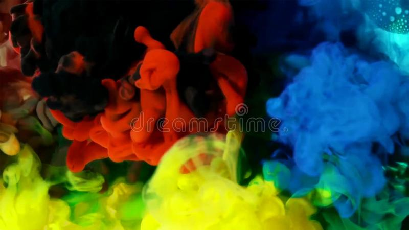 Colored liquids mixed together in fluid creating colorful abstract painting stock photos
