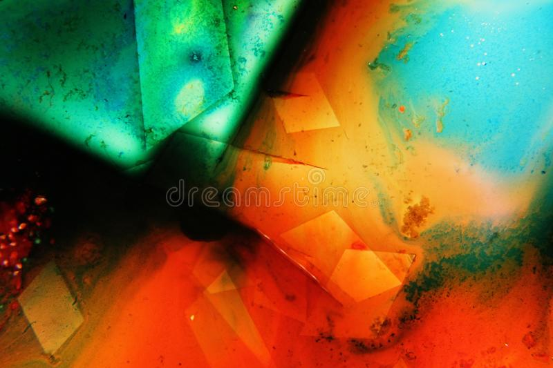 Colorful liquids mixed together to an abstract painting. Colored liquids mixed together in fluid creating colorful abstract painting consisting of gradients and stock images