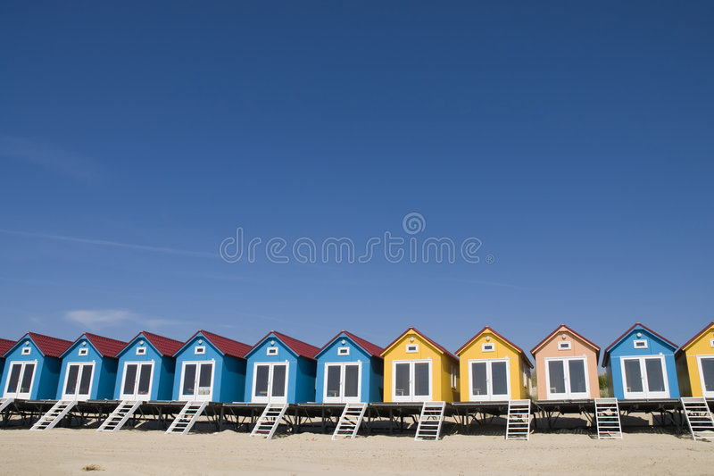 Colored little Beach-houses. Many colored little beachhouses on a row royalty free stock photos